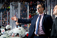 KELOWNA, BC - FEBRUARY 28: Kris Mallette of the Kelowna Rockets stands on the bench and gestures to ice officials during his first home game as interim head coach against the Everett Silvertips at Prospera Place on February 28, 2020 in Kelowna, Canada. (Photo by Marissa Baecker/Shoot the Breeze)