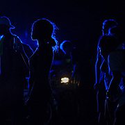 """Protesters are illuminated by police squad cars across the street from Market Street Park, where the controversial statue of Confederate Gen. Robert E. Lee stands on the second anniversary of the """"Unite the Right"""" rally in Charlottesville, W.V. on Saturday, August 11, 2018."""