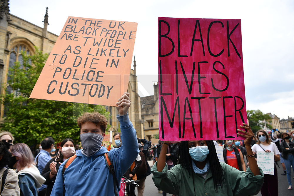 © Licensed to London News Pictures. 09/06/2020. Oxford, UK. Protesters take part in a demonstration outside Oriel College demanding Oxford University to take down the imperialist Cecil Rhodes statue.  The demonstration was organised by group Black Lives Matter in support for the American George Floyd who died whilst being arrested by US policemen Derek Chauvin. His death has caused civil unrest in some US cities. Photo credit: Ray Tang/LNP