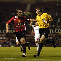 Photo. Jed Wee.<br />Manchester United v Dinamo Bucharest, UEFA Champions League Qualifying 2nd Leg, 24/08/2004.<br />Manchester United's Gary Neville (L) breaks out in a smile after the referee confirms the goal as there was confusion as he headed to consult his assistant