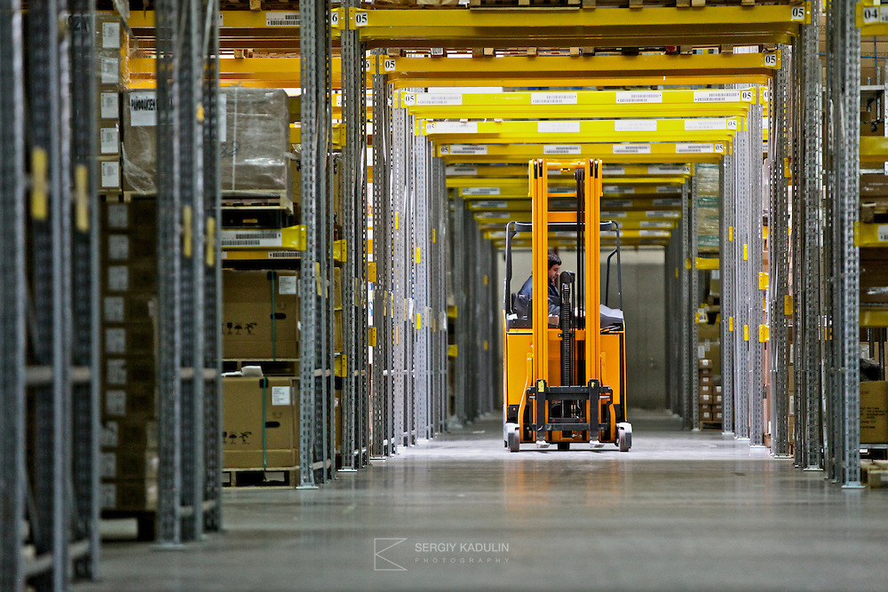 Commercial warehouse with electric cart operating.