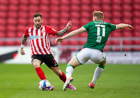 Football - 2020 / 2021 Sky Bet League One - Sunderland vs Lincoln City - Stadium of Light<br /> <br /> Chris Maguire of Sunderland vies with Anthony Scully of Lincoln City<br /> <br /> Credit: COLORSPORT/BRUCE WHITE