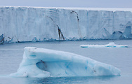 Iceberg in front of glacier wall, Svalbard, Norway