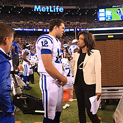 Indianapolis Colts quarterback Andrew Luck being interviewed during the New York Giants V Indianapolis Colts, NFL American Football Pre Season match at MetLife Stadium, East Rutherford, NJ, USA. 18th December 2013. Photo Tim Clayton