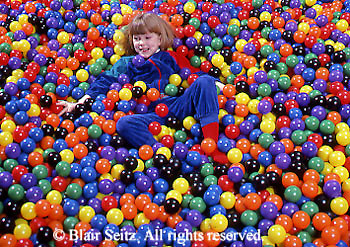 Medical , Occupational Therapy for Children, Therapy Apparatus, Therapist, Child Plays in Pool of Balls