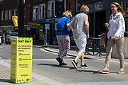 Local residents pass a Covid-19 public information display amid rising local concern regarding the spread of the Delta variant on 8th June 2021 in Wokingham, United Kingdom. Surge testing has been introduced in some local postcodes after a small number of cases of the Delta variant first identified in India were confirmed in the Wokingham area.