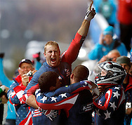 United States' Curtis Tomasevicz (C) celebrates with teammates Steven Holcomb (R), Justin Olsen, Steve Mesler (L) after winning a gold medal in the four-man bobsleigh event at the 2010 Winter Olympics in Whistler, Canada on February 27, 2010.  (UPI)