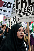 Protest against Israel's latest attack on Gaza, July 19th 2014 , Operation Protective edge. A young woman wearing a black veil.