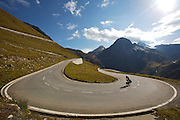 """Day 9 -  Can compare this to stage 3Brig to Grindelwald107.6 km (66.9 mi)Monday, June 13 Peter Sagan (SVK)  Find time and results from this stage: 3:09:47 and 10301 feet of climbing.  21.13 miles per hours.  Nearly three time as fast as average spped of touring bike on similar route.  <br /> <br /> Horst Hammerschmidt climbs a rung of switchbacks on (xxx) pass during the author's """"sweet passes"""" tour.  Over 10-days, the pair racked up 55,000 feet of vertical gain over the country's 14 most iconic passes on fully loaded touring bikes."""