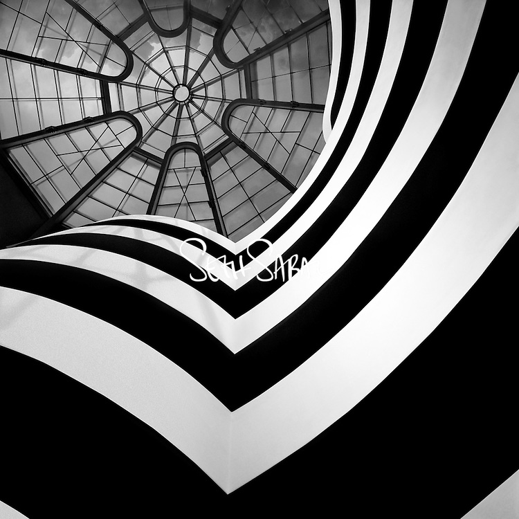 """The Solomon R. Guggenheim Museum, often referred to as The Guggenheim, is an art museum located at 1071 Fifth Avenue on the corner of East 89th Street in the Upper East Side neighborhood of Manhattan, New York City. It is the permanent home of a continuously expanding collection of Impressionist, Post-Impressionist, early Modern and contemporary art and also features special exhibitions throughout the year. The museum was established by the Solomon R. Guggenheim Foundation in 1939 as the Museum of Non-Objective Painting, under the guidance of its first director, the artist Hilla von Rebay. It adopted its current name after the death of its founder, Solomon R. Guggenheim, in 1952.<br /> <br /> In 1959, the museum moved from rented space to its current building, a landmark work of 20th-century architecture. Designed by Frank Lloyd Wright, the cylindrical building, wider at the top than the bottom, was conceived as a """"temple of the spirit"""". Its unique ramp gallery extends up from ground level in a long, continuous spiral along the outer edges of the building to end just under the ceiling skylight. The building underwent extensive expansion and renovations in 1992 and from 2005 to 2008."""