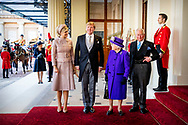 23-10-2018 -  LONDON - King Willem Alexander and Queen Maxima are welcomed by Queen Elizabeth and Prince Charles at Buckingham Palace after the welcome ceremony at the Horse Guards Parade at the start of a two-day state visit to the United Kingdom. COPYRIGHT ROBIN UTRECHT