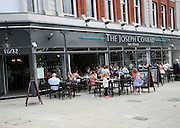 People sitting outside The Joseph Conrad Wetherspoons pub, Lowestoft, Suffolk, England