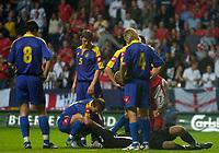 Fotball<br /> Foto: SBI/Digitalsport<br /> NORWAY ONLY<br /> <br /> England v Ukraina<br /> <br /> 18/08/2004. International Friendly<br /> <br /> Ukraine's keeper Oleksandr Shovkhovskyy lies injured after colliding with David Beckham as the England captain scored his side's opening goal.