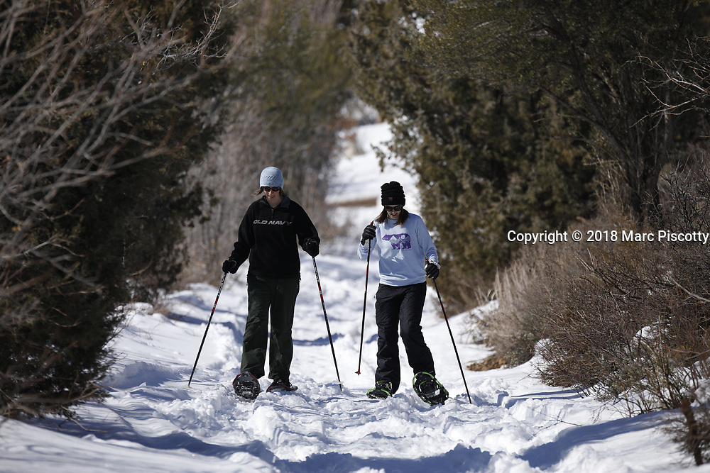 """SHOT 3/12/18 11:10:42 AM - Winter activities including cross country skiing, snowshoeing, tubing and winter fishing on Bear Lake in Garden City, Utah. Bear Lake is a natural freshwater lake on the Utah-Idaho border in the Western United States. The lake has been called the """"Caribbean of the Rockies"""" for its unique turquoise-blue color, which is due to the reflection of calcium carbonate (limestone) deposits suspended in the lake. Bear Lake is over 250,000 years old. (Photo by Marc Piscotty / © 2018)"""