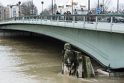 Due to heavy rains of recent days, a large flood of the Seine is underway in Paris provoking flooding at the docks. While the water level is expected to increase further to 6m20, the riverbank lanes have been closed to traffic and flood walls have been erected at various locations. The Zouave, statue 5.2 meters high, is the indicator of flood of the Seine in Paris. Paris, France, January 25, 2018. Photo by Samuel Boivin/ABACAPRESS.COM