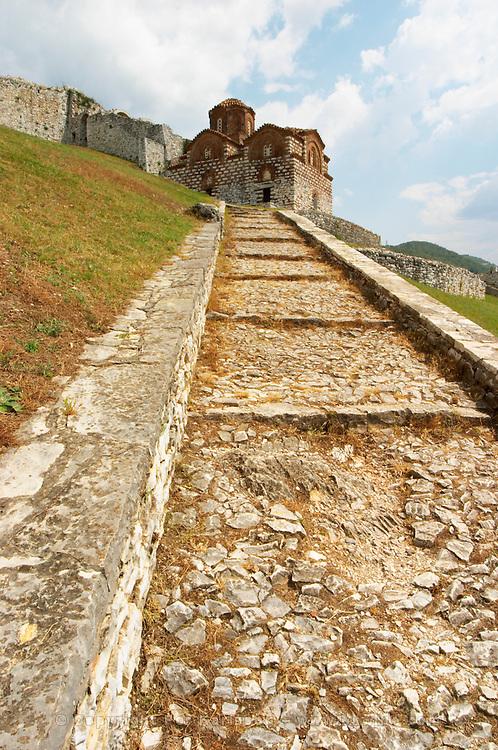 The Hagia Triada Church. Steep footpath with steps leading up. Berat upper citadel old walled city. Albania, Balkan, Europe.