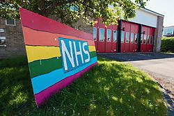 NHS support rainbow outside fire station during Coronavirus lockdown, Dorset UK May 2020