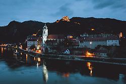 THEMENBILD - das beleuchtete Stift Dürnstein mit der Burgruine und der Donau am Abend, aufgenommen am 16. April 2021 in Dürnstein, Oesterreich // the illuminated Duernstein Abbey with the castle ruins and the Danube in the evening in Duernstein, Austria on 2019/04/16. EXPA Pictures © 2021, PhotoCredit: EXPA/ JFK