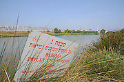 Israel, Bay of Haifa, Kishon River, with a pollution warning sign