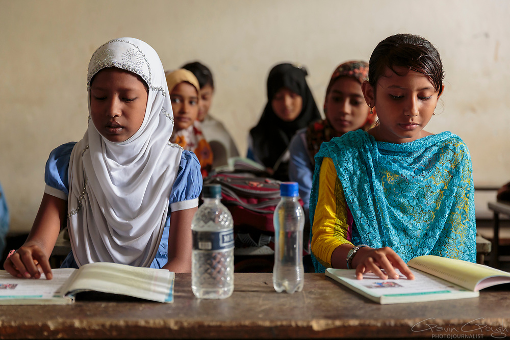 Girls studying in a primary school class