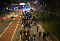 "© Licensed to London News Pictures;03/04/2021; Bristol, UK. Protesters march up Newfoundland Road to the start of the M32 which is blocked by police at a fifth ""Kill the Bill"" protest in a fortnight taking place in Bristol against the Police, Crime, Sentencing and Courts Bill during the Covid-19 coronavirus pandemic in England. Several arrests were made. The Bill proposes new restrictions on protests. Some previous Kill the Bill protests in Bristol had violence. Photo credit: Simon Chapman/LNP."