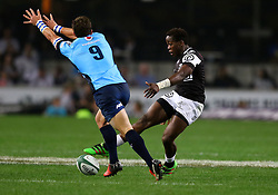 Inny Radebe of the Sharks is charged by Piet van Zyl during the Currie Cup match between the The Sharks and The Blue Bulls held at King's Park, Durban, South Africa on the 27th August 2016<br /> <br /> Photo by:   Anesh Debiky / Real Time Images