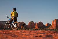 A mountain biker takes in the sunset while riding in Sedona, Arizona.