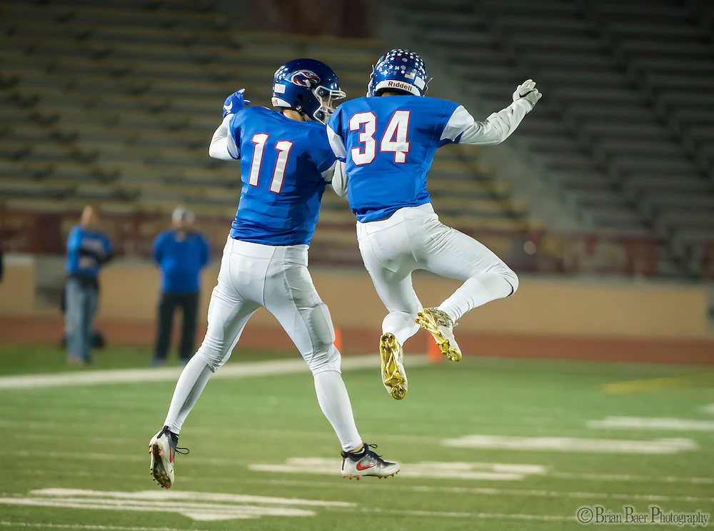 Christian Brothers Falcons Tyler Green (34), celebrates his interception with Christian Brothers Falcons Matt Marengo (11), during the first quarter of the Sac-Joaquin Section Division I football playoff game between the Christian Brothers Falcons and Cordova Lancers at Huges Stadium,  Friday Nov 11, 2016.<br /> photo by Brian Baer