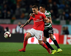 LISBON, Feb. 4, 2019  Alex Grimaldo (L) of Benfica vies with Raphinha of Sporting during the Portuguese League soccer match between SL Benfica and Sporting CP in Lisbon, Portugal, Feb. 3, 2019. Benfica won 4-2. (Credit Image: © Xinhua via ZUMA Wire)