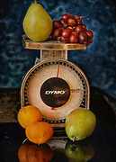 Still life with fruit and a scale in vintage.