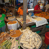 Merchants sell their wares in an outdoor market in upper Belem, a crowded neighborhood in Iquitos, Peru.