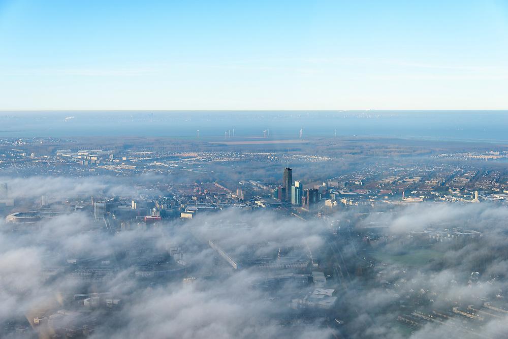 Nederland, Flevoland, Almere, 11-12-2013; Stadshart van Almere in de mist, de hoogbouw rond het station steekt net boven de wolken uit. IJsselmeer in de achtergrond.<br /> Heart of the newly constructed city of Almere in the fog.<br /> luchtfoto (toeslag op standaard tarieven);<br /> aerial photo (additional fee required);<br /> copyright foto/photo Siebe Swart.