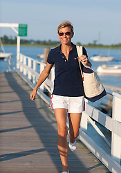 girl walking on a boat dock during the summer