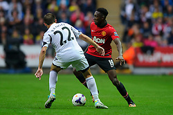 Man Utd Forward Danny Welbeck (ENG) is challenged by Swansea Defender Angel Rangel (ESP) during the second half of the match - Photo mandatory by-line: Rogan Thomson/JMP - Tel: Mobile: 07966 386802 17/08/2013 - SPORT - FOOTBALL - Liberty Stadium, Swansea -  Swansea City V Manchester United - Barclays Premier League - First round of the 2013/14 season and the first league match for new Man Utd manager David Moyes.