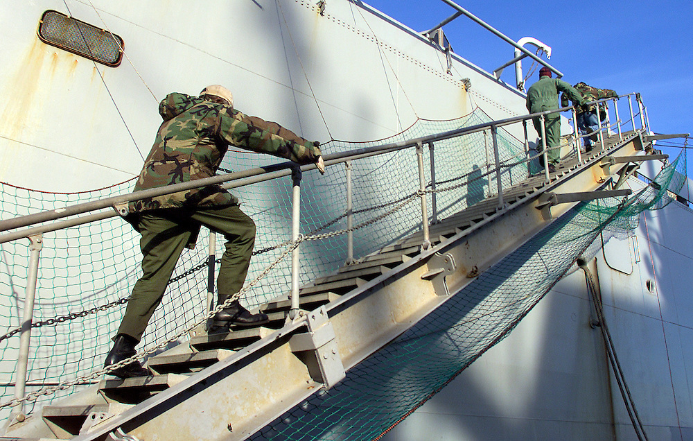 (PPAGE1) Sandy Hook 12/4/2002  Crew of the USNS Mount Baker boards the ship just prior to its departure for the Persian Gulf.    Michael J. Treola Staff Photographer.