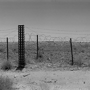 Sep 20, 2009 - Kandahar Province, Afghanistan - An abandoned section of NATO's Kandahar Airfield (KAF) which was once a section of where the Russians operated in the 1980's. Now mined and full of unexploded ordinance (UXO) it is fenced in with old Russian barbed wire.<br /> (Credit Image: © Louie Palu/ZUMA Press)