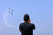 """An Israeli Air Force (IAf) """"Efroni"""" (T-6 Texan II) plane performs an aerobatic maneuver during Independence Day celebrations in Tel-Aviv, Israel April 15, 2021. People gathered in their masses at Tel-Aviv's shore line as the Jewish state celebrates 73 years to it's establishment. As vast percentage of the population are vaccinated, celebrations were able to take place in a some what ordinary manner.Starting Sunday April 18, 2021, it will no longer be mandatory to wear a protective mask in open spaces throughout the country."""
