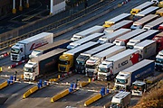 Lorries line up at control barriers for departure inside the Eastern Dock of the Port of Dover is where the cross channel port is situated with ferries departing here to go to Calais in France on the 29th of January 2020 in Dover, Kent, United Kingdom. Dover is the nearest port to France with just 34 kilometres 21 miles between them. It is one of the busiest ports in the world. As well as freight container ships it is also the main port for P&O and DFDS Seaways ferries.