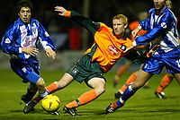 Photo. Chris Ratcliffe<br />Colchester United v Plymouth Argyle . FA Nationwide 3rd Division. 29/11/2003<br />Nathan Lowndes tries to get a shot in as kem Izzet left and liam chilvers challenge