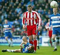 Photo: Scott Heavey.<br />Reading v Stoke City. Nationwide Division One. 13/03/2004.<br />Steve Sidwell lays motionless, after he felt he was fouled in the box by Gerry Taggart (Centre)