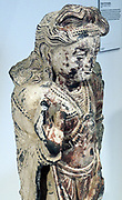 The bodhisattva Maitreya, Pakistan, Gandhara, 3rd century painted and gilded slate.  Maitreya, the Buddha of the future, is making the abhaya mudra, or 'fear not' gesture.  His webbed fingers are a sign of his divine nature.  This figure shows that Buddhist art in Gandhara, which was in contact via trade routes with religions around the Mediterranean Sea, was influenced by Greco-Roman sculpture.  The drapery folds of the Maitreya's lower garment, for instance, recall Roman figures, while his hairstyle is based on representations of the Greek god Apollo.