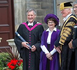 Michael Palin, comedian, broadcaster and writer best known for his work with Monty Python's Flying Circus and Ripping Yarns, in St Salvator's Quadrangle after he received an Honorary Degree at St Andrews University. Pic with Menzies Campbell, Chancellor of the University of St Andrews.