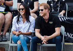 Prince Harry and his girlfriend Meghan Markle laugh while watching the wheelchair tennis competition during the Invictus Games in Toronto, ON, Canada, Monday September 25, 2017. This is Prince Harry's first public appearance with Markle. Photo by Nathan Denette/CP/ABACAPRESS.COM