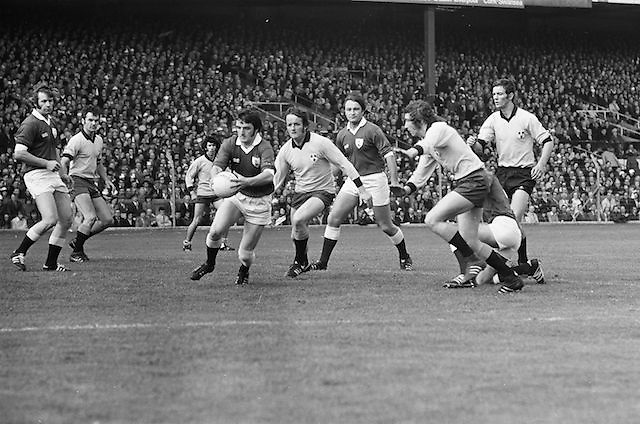 Galway player runs with the ball chased by Dublin team during the All Ireland Senior Gaelic Football Championship Final Dublin V Galway at Croke Park on the 22nd September 1974. Dublin 0-14 Galway 1-06.