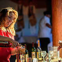 080515  Adron Gardner/Independent<br /> <br /> Sammy C's Rock N' Sports Pub & Grille general manager Deborah Sowers<br /> pours wine for guests during the Intertribal Ceremonial wine tasting at Red Rock Park Wednesday.