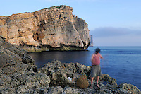 Maltese fisher with fishing trap, Fungus Rock in the background, Gozo, Maltese Islands