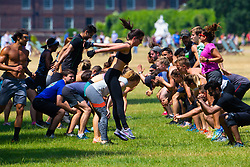 A group of young people exercise in the sunshine in Kensington Gardens as the heatwave continues with temperatures expected to soar. London, July 01 2018.