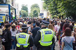 London, August 29th 2016. Police keep watch on the tens of thousands of revellers thronging the Streets of Notting Hill during day two of Europe's biggest street party, the Notting Hill Carnival.