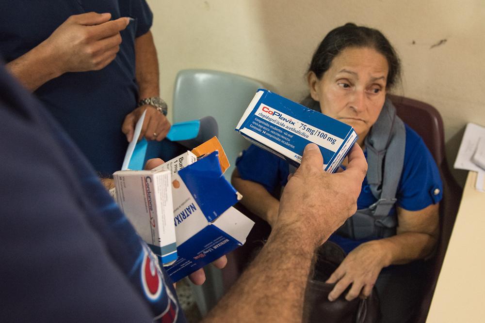 Neurosurgeons and interns review MRI's, and CAT scans during consultations at Occidente Hospital in Santa Rosa de Copan, Copan, Honduras, October 16, 2016.  Photo Ken Cedeno