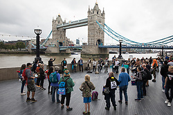 London, UK. 31st August, 2021. Environmental activists from Extinction Rebellion assemble alongside Tower Bridge on the ninth day of their Impossible Rebellion protests. Extinction Rebellion are calling on the UK government to cease all new fossil fuel investment with immediate effect.